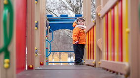 Little boy on playground equipment Royalty Free Stock Image
