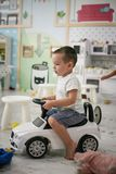 Little boy in playground. Little boy drawing children car. Lifestyle stock images