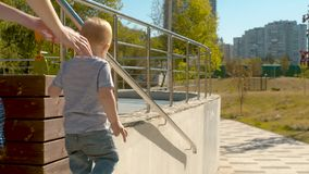 Little boy on the playground. In the park. Slow motion stock video footage