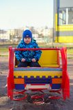 The little boy at a playground plays on the children's machine Stock Photos