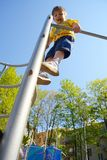 Little boy at playground plays sports. Fitness motivation Royalty Free Stock Images