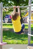 Little boy at playground plays sports. Fitness motivation Stock Photos