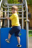 Little boy at playground plays sports. Fitness motivation Royalty Free Stock Photos