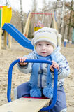 Little boy at the playground. Little boy running jumping on the playground Royalty Free Stock Image