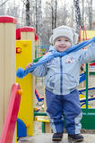Little boy at the playground. Little boy running jumping on the playground Royalty Free Stock Images