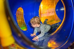 Little boy on the playground. Little boy in the playground tunnel Stock Photography