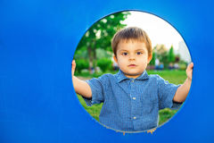 Little boy in playhouse Stock Images