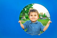 Little boy in playhouse Stock Photos