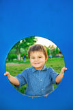 Little boy in playhouse Stock Image