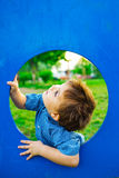 Little boy in playhouse Royalty Free Stock Photography