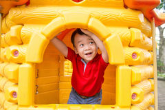 Little boy in playhouse Royalty Free Stock Images
