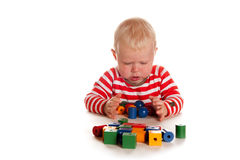 Little boy is playing Stock Photos
