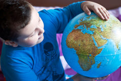 Little boy is playing. With globe Stock Images