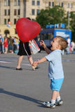 Little boy playing with air balloon Stock Image