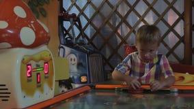 Little Boy Playing Air Hockey stock video