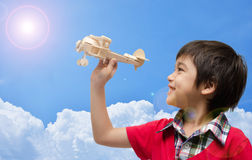 Little boy playing airplane wood toy Stock Photo