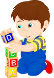 Little boy playing with alphabet block Stock Image