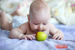 Little boy playing with apple indoors Stock Photos