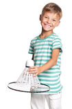 Little boy playing badminton Stock Photo
