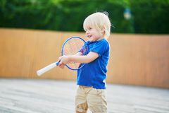 Little boy playing badminton with mom on the playground Royalty Free Stock Photos