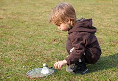 Little boy playing badminton outdoors Royalty Free Stock Image
