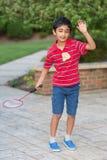 Little Boy Playing Badminton. Outdoors Stock Photo