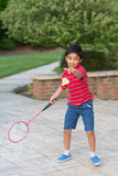 Little Boy Playing Badminton. Outdoors Stock Photography