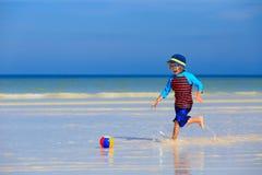 Little boy playing ball on summer beach Stock Photo