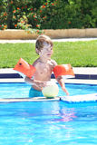 Little boy playing with a ball in a swimming pool Royalty Free Stock Image