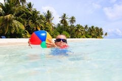 Little boy playing ball on tropical beach Stock Photography