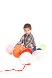 Little boy playing with balloons Stock Image