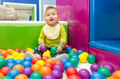 Little boy playing with balls Stock Photo
