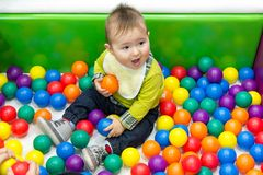 Little boy playing with balls Stock Photos