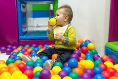 Little boy playing with balls Royalty Free Stock Image