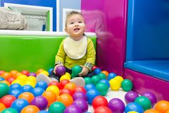 Little boy playing with balls Stock Image