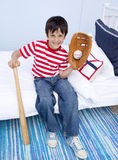 Little boy playing baseball in bed Royalty Free Stock Images