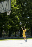Little boy playing basketball. Outdoors, ready to throw the ball outdoors Royalty Free Stock Photography