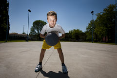 Little boy playing basketball. Outdoors, ready to throw the ball Stock Photos