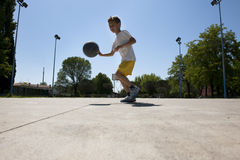 Little boy playing basketball. Outdoors, dribbling Royalty Free Stock Images