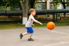 Little boy playing basketball Stock Photo