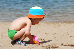 Little boy playing on the beach Stock Photo