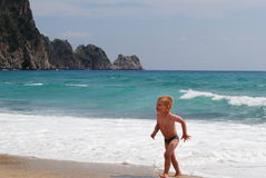 Little boy playing on the beach. In the hot,summer day royalty free stock photography