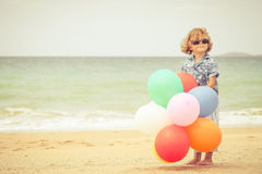 Little boy playing on the beach at the day time Royalty Free Stock Images