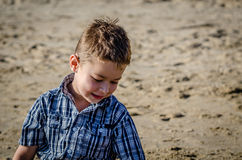 Little Boy playing at beach Stock Image