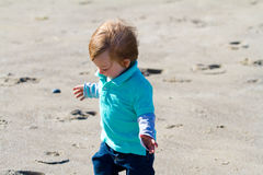 Little Boy Playing at Beach Royalty Free Stock Images