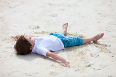 Little boy playing at beach Royalty Free Stock Image