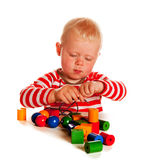 Little boy playing with beads Stock Photos