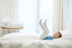 Little boy playing in a bed stock photography