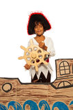 Little boy playing being pirate on cardboard ship Stock Photos