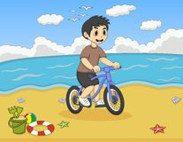 Little boy playing bicycle on the beach cartoon Stock Photo